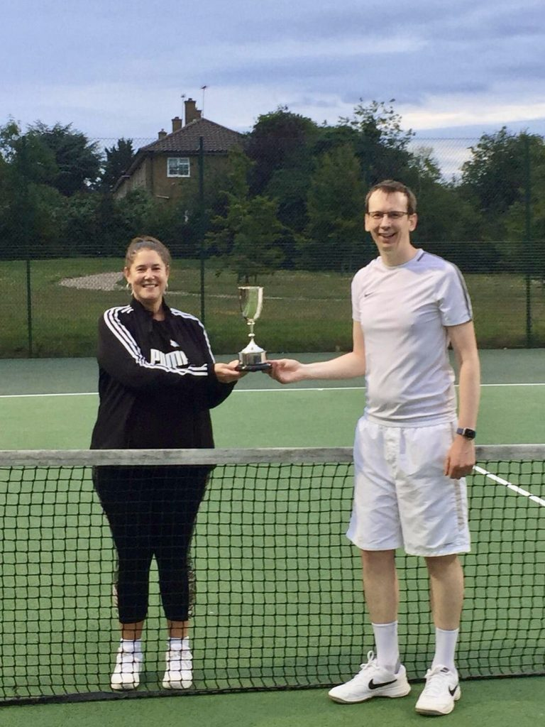 Photograph of the Mixed Doubles Handicap Champions with trophy.